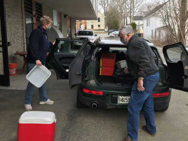 loading car with coolers for meals on wheels